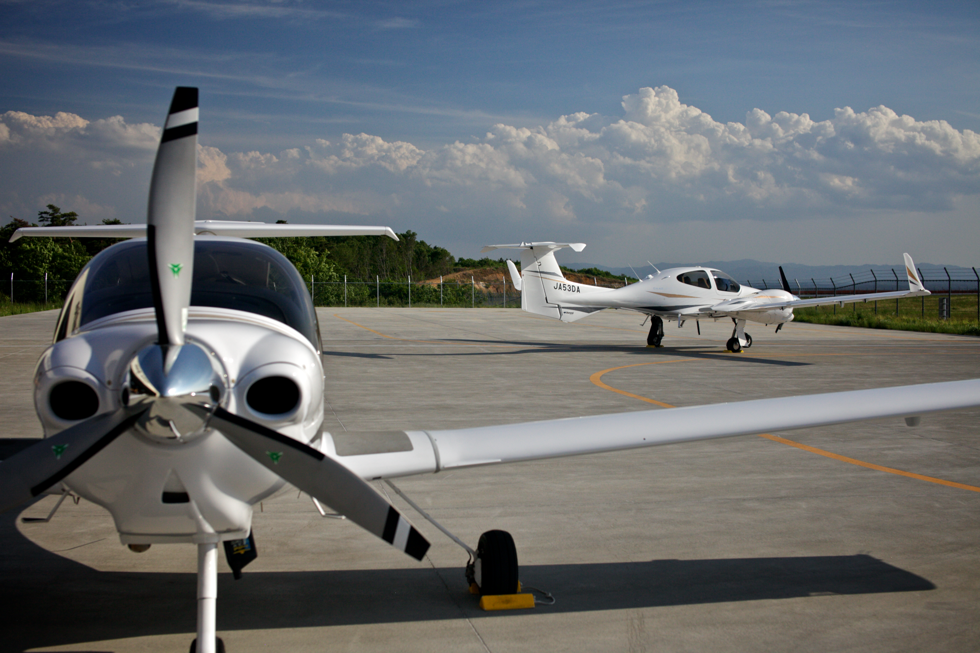 A DA-40 and DA-42 bask in the afternoon sun